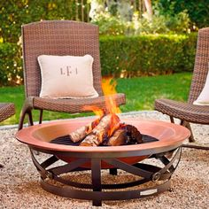 Example Patio Chair with Hidden Ottoman Copper Fire Pit, Wood Burning Fire Pit, Fire Pit Chairs, Patio Chairs, Home Landscaping, Landscaping With Rocks, Porches, Outside Fire Pits, Outdoor Ottomans
