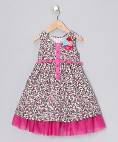 Decorated with a pretty floral print, eye-catching fuchsia trim and a quartet of blooming blossoms, this fanciful corduroy frock is as sweet and charming as a big bouquet. The smocked back and soft fabric ensure a comfortable fit. Shell and lining: 100% cottonContrast: 47% cotton / 47% modal / 6% spandexMachine wash; dry...