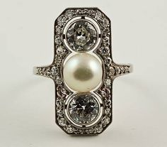 "bejeweledfoundation: ""Smithsonian Jewels Spam Edwardian Diamond & Pearl RingProbably made sometime between 1910 - 1920, this ring showcases a large white pearl and two old European cut diamonds, surrounded by small round cuts in a platinum..."
