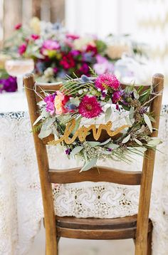 "Glittery ""love"" garland as chair swag 