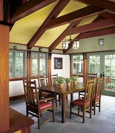 Craftsman architecture creates an open and airy dining room, highlighted by a cheerful color scheme and a beautiful outdoor view. Dining Decor, Dining Area, Dining Rooms, Craftsman Dining Room, Mission Style Homes, Exposed Rafters, Yellow Ceiling, Tiny Spaces, Craftsman Style