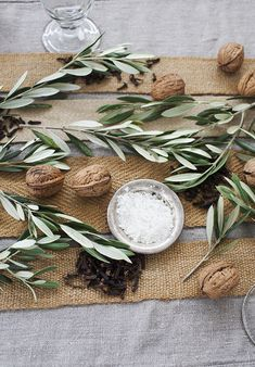 table decorated with olive branches, walnuts, linen and feathers… KARA ROSENLUND.COM