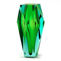 """Artist Katerina Doušová's masterpiece is evocative of a gemstone whose cut facets allow for a remarkable interplay of light. Hand blown and hand cut crystal from Moser.     Measures 10"""" h."""