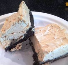Frozen Peanut Butter and Chocolate Dessert Bars 30 Oreos 6 tbsp melted butter 1 cup creamy peanut butter 1/2 cup heavy cream 8 oz tub frozen whipped topping, thawed
