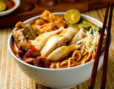 Asian Food / Egg noodles cooked in a rich curry broth (Laksa)... spicy and packed with lots of Asian heat and flavor!