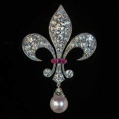 View this item and discover similar for sale at - Circa 1900 This superbly modeled antique fleur-de-lis brooch is finely handcrafted in silver topped gold (front – silver, back – gold). The brooch Sea Glass Jewelry, Pearl Jewelry, Bridal Jewelry, Antique Jewelry, Vintage Jewelry, Cartier Jewelry, Swarovski Jewelry, Vintage Rings, Diamond Jewelry