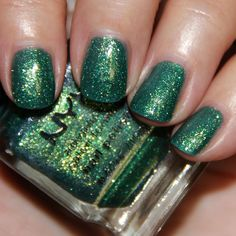 """NYX Nail Polish """"Enchanted Forest""""- is a green base with heavy gold and green glitter. Another total stunner! Love how sparkly and shiny this color looks. Two coats."""