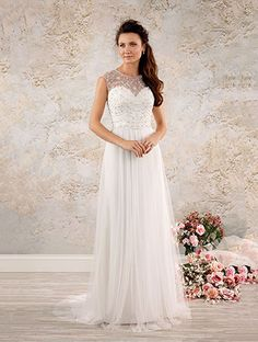 An elegant A-line wedding gown with a sheer sleeveless yoke, decorated sweetheart, natural waist bodice, and chapel train.