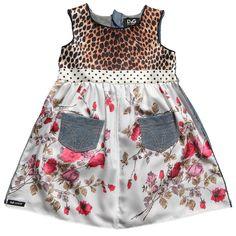 Image from http://3.bp.blogspot.com/-lk9-sObOeFA/T4MUxoiFVJI/AAAAAAAABjw/6fSuXMISDPA/s1600/dolce+gabbana+dg+junior+baby+dress+infant+spring+2012.jpg.