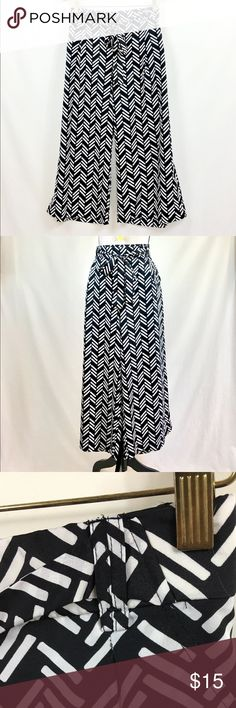 """ZARA Culottes Black & White W/Tie Waist These have a graceful drape, elegantly wide legs & adjustable tie waist. Mostly feel like a skirt, work great w/flats, wedges, sandals, boots.  I'm 5-10 w/long legs, they fall lower calf on me.  Wide elastic waistband. Attached self-fabric sash. Diagonal slash pockets. 2 front belt loops, each over a single pleat. Unlined. Waist 37; Rise 13; 34.25"""" long  """"Good to Excellent Pre-Owned"""": worn more than 3 times, no visible signs of wear.  100% Polyester…"""