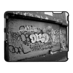 'GRAFFITI GATES' iPAD CASE, by The Flying Pig Gallery on Zazzle (lizadeyphoto) - A black & white photo of a graffiti covered store gate on a condemned building in New York City gives this iPad case a gritty, urban feel.
