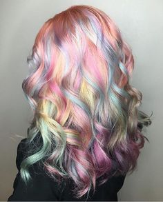 Gorgeous pastel rainbow hair by @caitlinfordhair