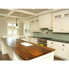 love this kitchen! I would change the color of the bottom cabinets and the counter top on the far counter