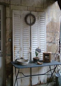 white shutters- maybe old bifold doors..