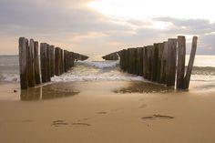 Vlies fotobehang Golvend water - Strand behang | Muurmode.nl