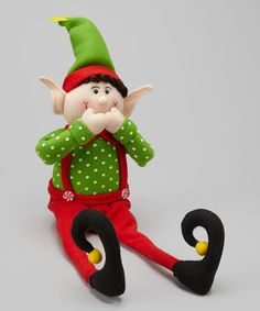 Set this sweet figurine on any shelf for a charming touch of Christmas spirit. Soft fabric construction ensures that it's safe for little hands, too.