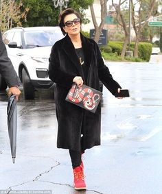 Slithery: Kris Jenner made a not-so-subtle dig at Blac Chyna as she accessorised with a snake clutch bag for a lunch date in Calabasas, California, on Wednesday