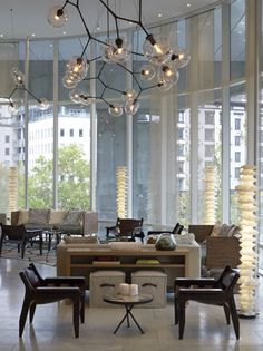 living-rooms-chandeliers-concrete-floors-curtains-hotels-lounge-chairs