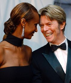 During happier times, David Bowie has his wife Iman are pictured sharing a moment at the Council of Fashion Designers of America Fashion Awards in New York on June 3, 2002.
