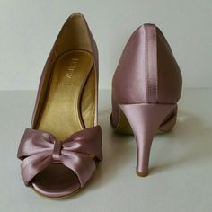 J Crew Lilac Peep Toe Pumps w/ Bows J Crew Lilac Peep Toe Pumps w/ Bows. Worn once w/ no heel wear. 3 in heel.   No Trade or PP.  Offers Considered.  Bundle discounts. J. Crew Shoes Heels