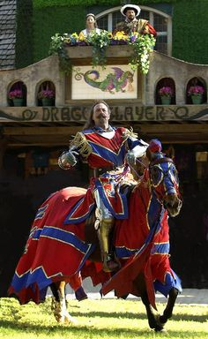 A Knight below, with King/Queen in balcony at the Texas Renaissance Festival