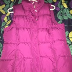 Hot pink sleeve less jacket. (Vest) Hot pink sleeve less jacket. Black stain not to noticeable only worn a few times. Very warm Old Navy Jackets & Coats Vests