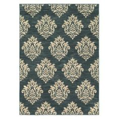 LOVE! Its actually teal (not navy) with charcoal accent stripes. The damask print is off white with tan accent stripes. This will pull all of the colors in my living room together! Target: Shaw Living; Damask Area Rug - Navy