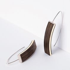 The attraction of Kaari earrings is based on a elegant curved line, which starts from the wooden part and continues to the hooks. Kaari means arc. The earrings are handmade of smoked oak, birch and recycled silver. White Earrings, Jewelry Branding, Attraction, Cuff Bracelets, Smoke, Birch, Silver, Leather, Handmade