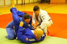 Helping students with technique in Brazilian Jiu-Jitsu Portsmouth Classes http://www.pureartbjj.com/group-classes-brazilian-jiu-jitsu.html