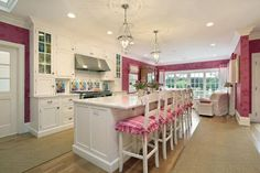 Love this elegant kitchen! #White cabinets, #Pink walls and chair pads, #Marble countertops - just stunning!