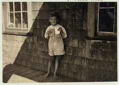 Five year old Preston, a young cartoner in Seacoast Canning Co., Factory #2. I saw him at work different times during the day--at 7 a.m., in the afternoon, and at 6 p.m., and he kept at it very faithfully for so young a worker.  Location: Eastport, Maine.
