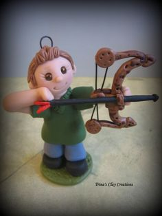 Boy with Bow, Compound Bow, Polymer Clay Ornament, Keepsake, Cake Topper ~ Trina's Clay Creations via Etsy.