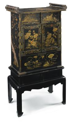 A Japanese parcel-gilt black and red lacquer cabinet on stand 19th century | Lot | Sotheby's