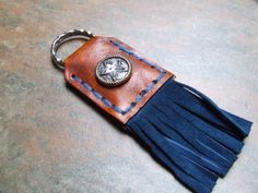 Fringed leather keyring - with jewelled concho, supplies from The Identity Store website...