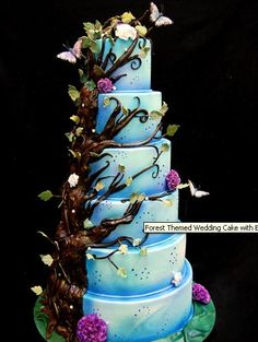enchanted forest wedding cake. Minus butterflies and more purple And green, then perfect :)