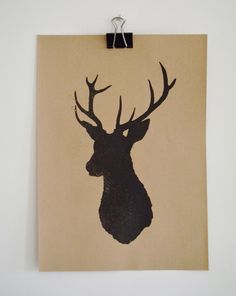 Stag's head silhouette print with screen printed distressed effect on brown recycled ribbed Kraft paper.. £20,00, via Etsy.