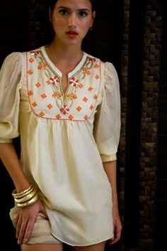 Simple yet making a statement. Hand work and Gold thread overlay. White Cotton Satin and interesting cuts. Get this in your favourite color only on www.faaya.in