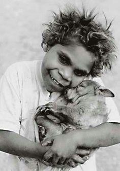 Australian aboriginal boy holding wombat