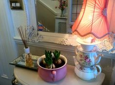 Re use, re cycle and up cycle.. An old bed pan into a wonderful planter and re use some dis used tea pots and cups and saucers and make into a lamp!