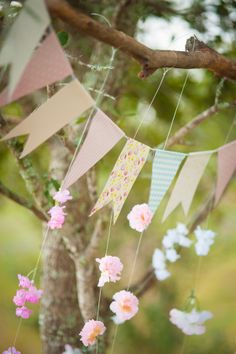 Bunting & paper flower garlands work a treat for wedding reception decorations x
