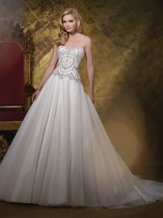 James Clifford Collection - J11585 - Wedding Dresses 2015 Collection – Strapless hand-beaded motif, tulle and sequin over tiara satin ball gown wedding dress with sweetheart neckline, elaborately jewel beaded motif bodice with unique zigzag natural waistline, softly gathered tulle and sequin layered skirt with chapel length train, detachable spaghetti and halter straps included.Sizes: 2 – 20Colors: Ivory/Cream, Ivory, White