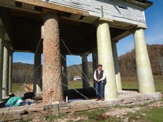 "Straightening the leaning column at Blue Sulphur Springs. ""Sika"" wrap adds extra strength to the 1838 Spring House columns."