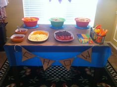 Camping Birthday Party with a build a pizza bar