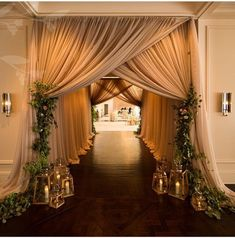 Add elegance and class to your big day with this beige and brown drapes and green orchids, or give it a traditional spin with marigolds and golden drapes, this will surely make the entry look amazing. #ShlokaEvents #DestinationWedding #RoyalWedding #ShlokaWedding