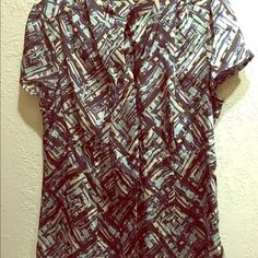 apt.9 Silk blouse Great condition, clean, ties in the front, it has 4 colors on it. Apt. 9 Tops Blouses