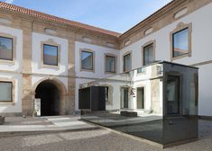 Renovated Baroque museum in Portugal features a mirror-clad ticket office.