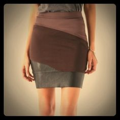 Host Pick VPL Curvate Skirt VPL Curvate color blocked skirt in shades of brown. 94% viscose/6% elastane. Bottom/darkest brown section is imitation leather/faux-leather. Hand wash (no dry clean needed!) Size 2. Like new condition. VPL Skirts