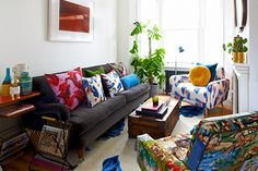 Henry Holland's Living room with bright colourful cushions