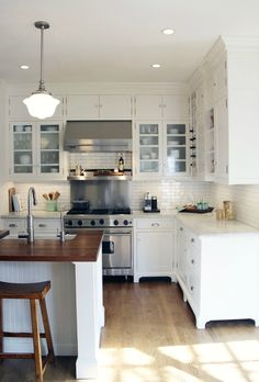 These cabinets are PERFECT. Exactly what I want. The feet, the trim along the bases, the doors, the hardware but in bronze. Love them!