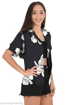 Floral Womens Hawaiian shirt black with large white hibiscus. Floral button down blouse with open collar perfect for a luau, fancy dress party, uniform, casual or cruise. #hawaiianshirt #ladiesshirt #ladieshawaiianshirt #fancydress #uniform #luau #cruise #cruisewear #springbreak #barshirt #schoolies #luaushirt #luau #partyshirt #bluehibiscusshirt #floralshirt #uniforms